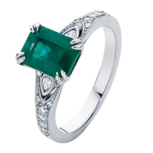 emerald side stones engagement ring white gold