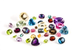 A grouping of different faceted gemstones
