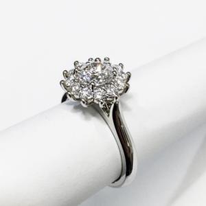 Round Brilliant Cut Diamond in a Snowflake Halo Design