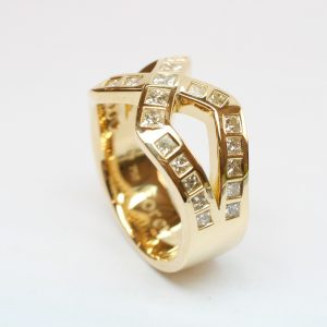 Crossover Design Dress Ring in Yellow Gold Featuring Gypsy Set Princess Cut Diamonds
