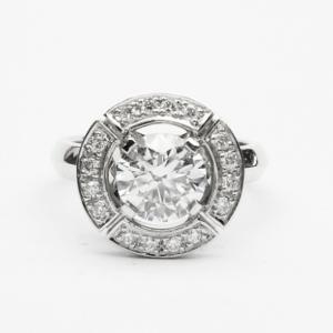 Round Brilliant Cut Diamond in a Grain Set Segmented Halo Design Ring