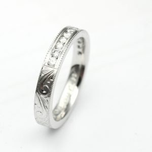 Hand Engraved Wedding Band with Channel Set Diamonds and Mill Grain Edges