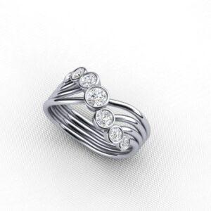 Contemporary Seven Stone Ring Featuring Bezel Set Round Brilliant Cut Diamonds