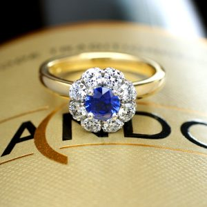 Round Cut Ceylon Sapphire Surrounded by Diamonds in a Flower Cluster Design