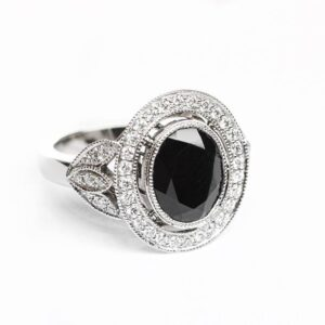 Oval Black Spinel in a Vintage Style Halo Design with Leaf Detail Shoulders