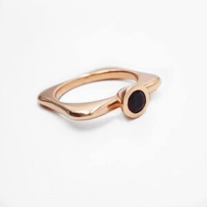 Contemporary Design Rose Gold Ring Featuring a Round Black Sapphire