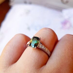 Cushion Cut Green Sapphire Ring with Grain Set Diamond Shoulders and Hand Engraving