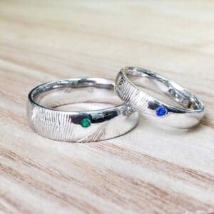 Custom White Gold Wedding Rings Featuring Fingerprint Engraving and Birthstones