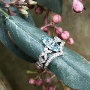 Marquise Cut Aquamarine Ring with Diamond Set Shoulders and V Shaped Diamond Wedding Ring