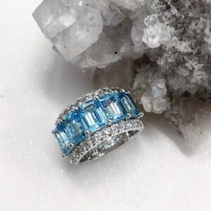 Emerald Cut Blue Topaz 5 Stone Ring with Diamond Set Side Bands