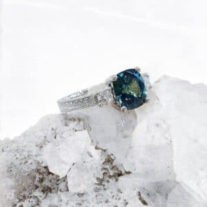 Cushion Cut Australian Parti Sapphire and Diamond Ring with a Hand Engraved Band