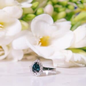 Pear Shape Teal Sapphire in a Diamond Halo Design