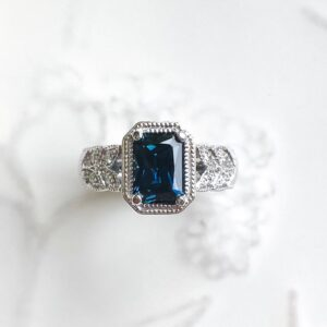 Radiant Cut Australian Sapphire Ring with Diamond Set Leaf Design Shoulders