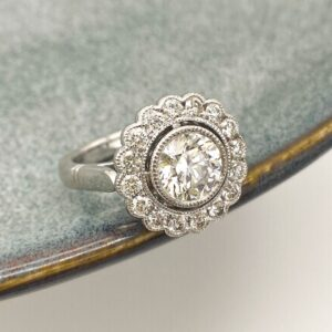 Round Brilliant Cut Diamond Vintage Inspired Halo Design Featuring Mill Grain