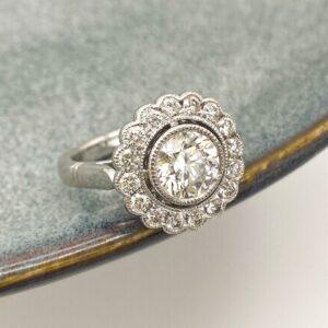 Round Brilliant Cut Diamond Vintage Inspired Halo Design Featuring Mill Grain