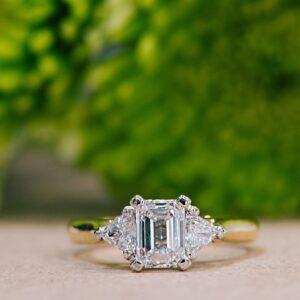 Emerald Cut Diamond and Trilliant Cut Diamond Three Stone Ring