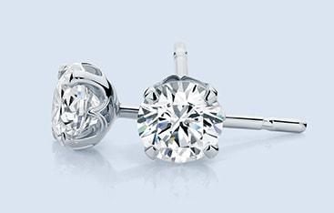 diamond claw stud earrings