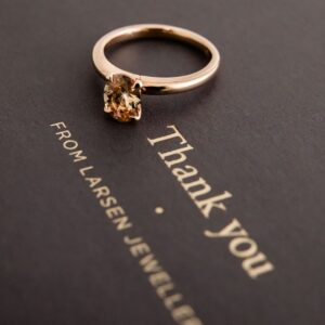 Oval Champagne Diamond Claw Set in a Rose Gold Solitaire Ring