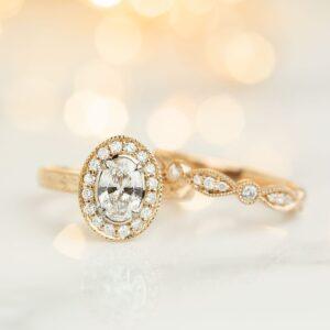 Oval Diamond Halo Design Engagement Ring with a Matching Diamond Set Wedding Ring