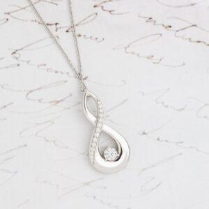 Twist Design Diamond Pendant with Grain Set Diamonds