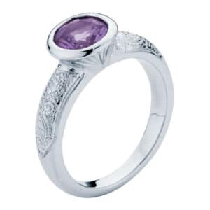 Bezel Set Amethyst with a Hand Engraved White Gold Band