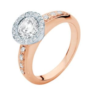 Round brilliant cut diamond with a grain set bezel and a rose gold diamond band