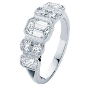 Vintage Inspired Engagement Ring Featuring Emerald Cut and Brilliant Cut Diamonds with Mill Grain Detail