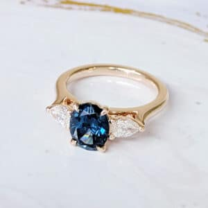 oval teal sapphire ring