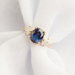 An Australian Sapphire engagement ring with marquise diamond accents in rose gold