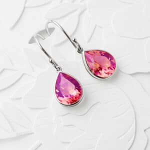 Vibrant pink sapphire earrings in a platinum setting