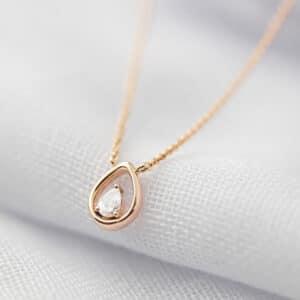 Rose Gold tear shape pendant with pear diamond centre stone