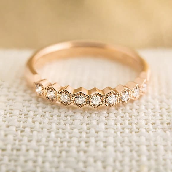 Custom made wedding ring in rose gold with diamonds
