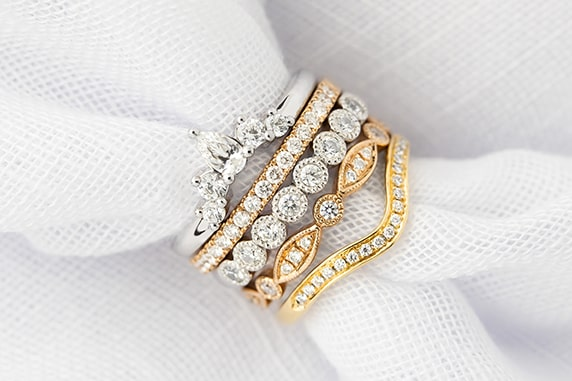 Stack of custom made wedding rings in white gold, platinum, rose gold and yellow gold made in Australia