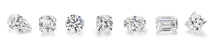 Collection of diamonds in different shapes such as round brilliant, princess, cushion, oval and pear