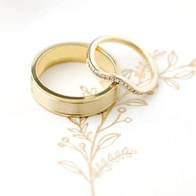 Yellow Gold brushed metal and curved diamond wedding rings handmade in a make your own wedding ring workshop.