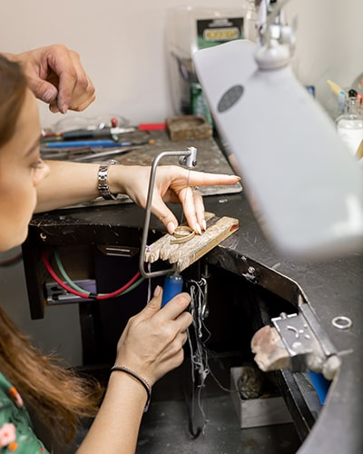 Bride-to- be hand making her fiance's wedding ring during a Larsen Wedding ring experience