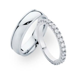 A set of mens and womens wedding rings in white gold with diamonds