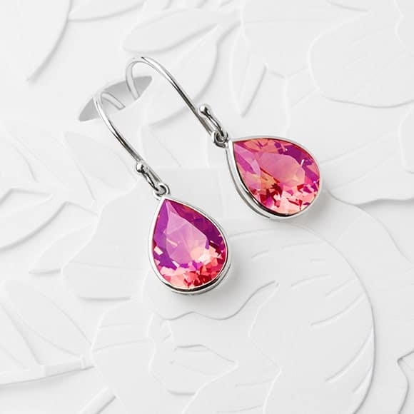 A pair of vibrant pink sapphire earrings in white gold