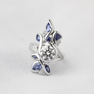 Round Brilliant Cut Diamond Ring Featuring Sapphire and Diamond Accents