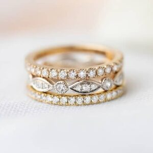 Stack of rose gold white gold and yellow gold wedding rings