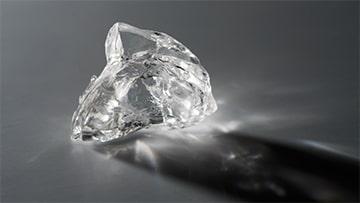 An uncut natural diamond, also knows as a rough diamond
