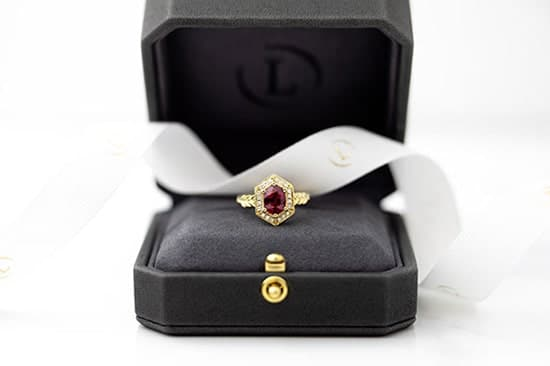 A custom designed and made Ruby Dress ring in a Larsen Jewellery ring box