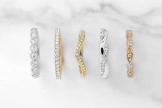 A row of bespoke eternity rings that are custom made to fit with your engagemnt and wedding ring.