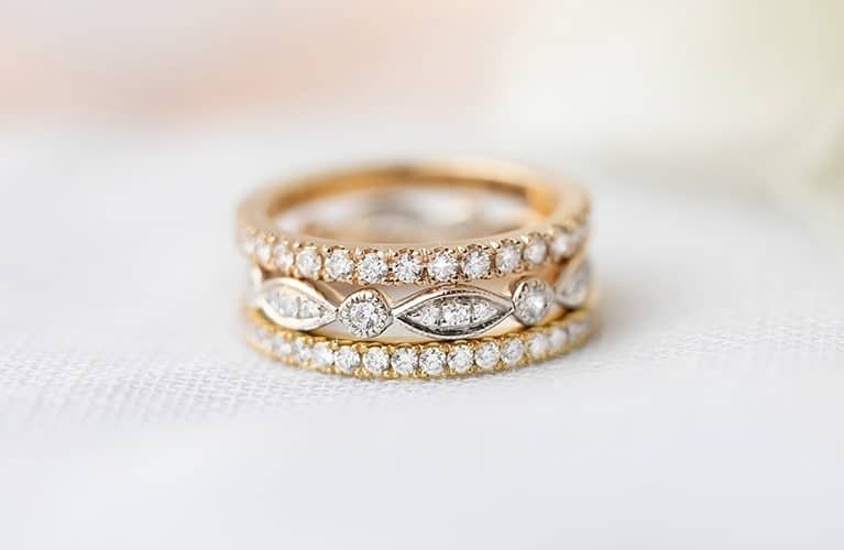 Stack of rose gold white gold and yellow gold wedding rings made in Sydney