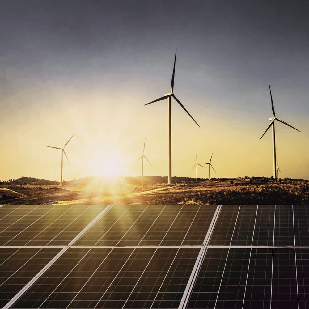Wind turbines in a field, reducing the carbon footprint of Larsen Jewellery