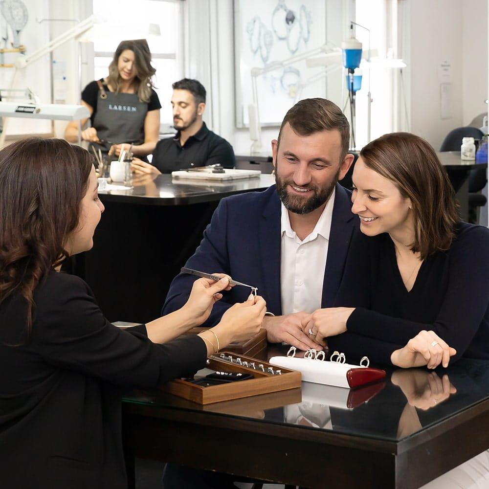 Friendly service from a jeweller in a Larsen Jewellery Studio.