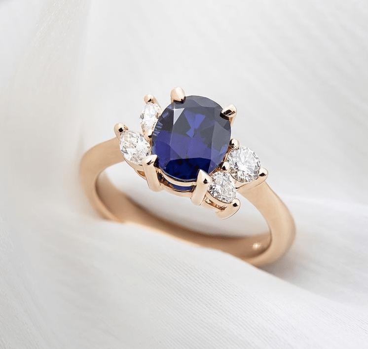 Asymmetrical rose gold sapphire ring